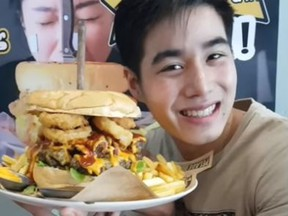 Chris Steaks and Burgers in Bangkok, Thailand is offering a cash prize to anyone who can eat this giant burger in nine minutes. (YouTube)