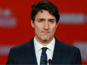 Liberal leader and Canadian Prime Minister Justin Trudeau stands on stage after the federal election at the Palais des Congres in Montreal, Quebec, Canada October 22, 2019.