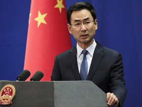 In this file photo dated Tuesday, Jan. 29, 2019, Chinese Foreign Ministry spokesman Geng Shuang speaks during a daily briefing at the Ministry of Foreign Affairs office in Beijing. (AP Photo/Andy Wong, FILE)