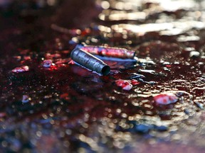"""Ammunition shells lay on a pool of blood in a street of Culiacan, capital of jailed kingpin Joaquin """"El Chapo"""" Guzman's home state of Sinaloa, on October 17, 2019. (RASHIDE FRIAS/AFP via Getty Images)"""