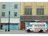 An educational services bus for children sits in front of vacant buildings on Broadway in Gary, Indiana, Thursday, April 20, 2006.  Gary, Indiana, a once thriving steel town where the poverty rate is more than double the U.S. average,  has failed to boost its fortunes with casinos and beauty pageants. Now, it's betting on boxing.  Promoter Don King approached Gary in February about staging a fight. Elected officials say they need to boost tourism after Donald Trump sold a casino and moved the Miss USA Pageant.  Critics say the city of 100,000, where 26 percent of residents live in poverty, should improve housing to draw homeowners from Chicago 10 miles northwest.  Photographer: Joe Tabacca/Bloomberg News
