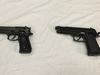FILE - This April 28, 2016, file photo shows a semi-automatic handgun, left, next to a Powerline 340 BB gun, right, displayed during a news conference in Baltimore. A Manitoba judge is calling for new rules governing imitation firearms, in order to reduce the risk of fatal shootings involving police and so-called suicides-by-cop. THE CANADIAN PRESS/AP-Juliet Linderman