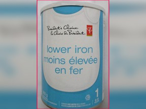 A 900-gram container of President's Choice: Lower Iron milk-based powdered infant formula.