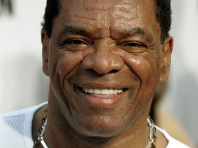 """Actor John Witherspoon poses at the premiere of his new comedy film """"Little Man"""" in Los Angeles July 7, 2006. (REUTERS/Fred Prouser/File Photo)"""