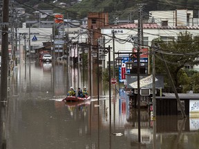 Police officers search an area by boat that was flooded by Typhoon Hagibis on October 14, 2019 in Marumori, Miyagi, Japan. (Tomohiro Ohsumi/Getty Images)