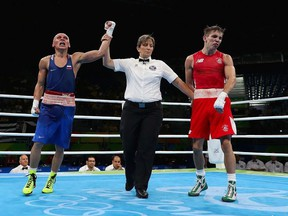 Vladimir Nikitin of Russia celebrates his victory over Michael John Conlan of Ireland in the boxing  Men's Bantam Quarterfinal 1 on Day 11 of the Rio 2016 Olympic Games at Riocentro on August 16, 2016 in Rio de Janeiro, Brazil.