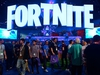 "(FILES) In this file photo taken on June 12, 2018, people crowd the display area for the survival game Fortnite at the 24th Electronic Expo, or E3 2018, in Los Angeles, California. - No bullets, no bombs. Players of the hugely popular online game Fortnite were encouraged to pause for a moment of silence on November 11, 2019 to commemorate the armistice that ended the First World War. The Royal Canadian Legion partnered with digital marketing company Wunderman Thompson and content creator Jadan Allen to design a virtual ""Remembrance Island"" in the game, which is played by some 250 million people worldwide. (Photo by Frederic J. BROWN / AFP) (Photo by FREDERIC J. BROWN/AFP via Getty Images)"