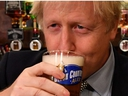 Britain's Prime Minister Boris Johnson sips a pint of beer at the Lynch Gate Tavern in Wolverhampton, Britain, November 11, 2019.