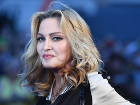 """Madonna poses arriving on the carpet to attend a special screening of the film """"The Beatles Eight Days A Week: The Touring Years"""" in London on Sept. 15, 2016."""