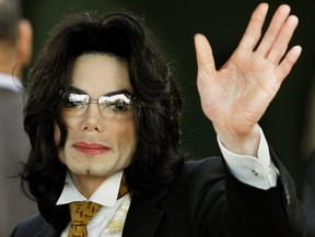 In this file photo taken on June 3, 2005, Michael Jackson waves as he arrives at the Santa Barbara County courthouse in Santa Maria, Calif.