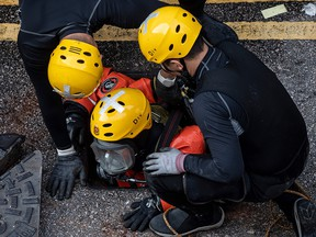 A rescue diver from the fire services department enters the sewage system to search for protesters, who escaped from Hong Kong Poytechnic University after being barricaded inside for days on November 20, 2019. (PHILIP FONG/AFP via Getty Images)