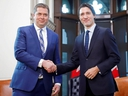 Conservative Party Leader Andrew Scheer shakes hands with Prime Minister Justin Trudeau on Parliament Hill in Ottawa, on Tuesday, Nov. 12, 2019.