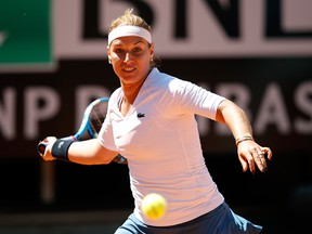 Dominika Cibulkova of Slovakia plays a forehand against Naomi Osaka of Japan in their Women's Singles Round of 32 Match during Day Five of the International BNL d'Italia at Foro Italico on May 16, 2019, in Rome, Italy.