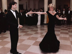 In this Nov. 9, 1985, photo provided by the Ronald Reagan Library, actor John Travolta dances with Princess Diana at a White House dinner.