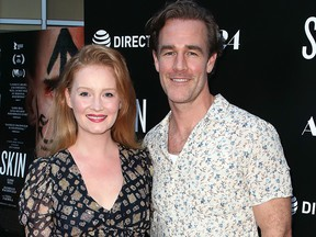 """In this July 11, 2019, file photo, Kimberly Brook and James Van Der Beek attend the L.A. Special Screening of A24's """"Skin"""" at the ArcLight in Hollywood, Calif.."""