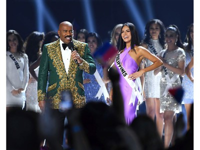 Steve Harvey interviews Miss Philippines Gazini Ganados onstage at the 2019 Miss Universe Pageant at Tyler Perry Studios in Atlanta, Ga., on Dec. 8, 2019.