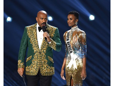 Steve Harvey and Miss South Africa Zozibini Tunzi speak onstage at the 2019 Miss Universe Pageant at Tyler Perry Studios on Dec. 8, 2019 in Atlanta, Ga.