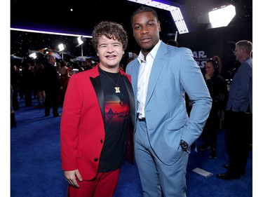 "(L-R) Gaten Matarazzo and John Boyega attend the premiere of Disney's ""Star Wars: The Rise of Skywalker"" on Dec. 16, 2019 in Hollywood, Calif."