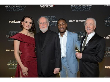 "(L-R) Daisy Ridley, composer John Williams, John Boyega and Anthony Daniels arrive for the  world premiere of ""Star Wars: The Rise of Skywalker,"" the highly anticipated conclusion of the Skywalker saga on Dec. 16, 2019 in Hollywood, Calif."