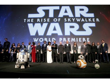 "(L-R) Anthony Daniels, Billy Dee Williams, Joonas Suotamo, Kelly Marie Tran, Keri Russell, Oscar Isaac, John Boyega, Daisy Ridley, Mark Hamill, Adam Driver, Naomi Ackie, Richard E. Grant, Ian McDiarmid, The Walt Disney Company chairman and CEO Bob Iger, producer and president of Lucasfilm Kathleen Kennedy, director, writer and producer J.J. Abrams, composer John Williams, producer Michelle Rejwan, Writer Chris Terrio and executive producer Callum Greene speak onstage during the  world premiere of ""Star Wars: The Rise of Skywalker,"" the highly anticipated conclusion of the Skywalker saga on Dec. 16, 2019 in Hollywood, Calif."