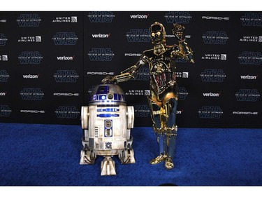 "R2-D2 (L) and C-3PO arrive for the world premiere of Disney's ""Star Wars: The Rise of Skywalker"" on Dec. 16, 2019 in Hollywood, Calif."