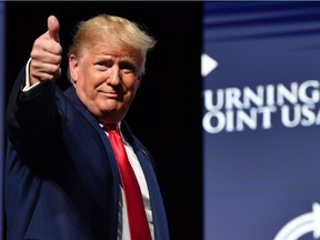 US President Donald Trump gestures during the Turning Point USA Student Action Summit at the Palm Beach County Convention Center in West Palm Beach, Florida on Dec. 21, 2019.