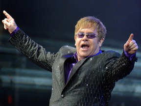 In this file photo taken on June 30, 2012 singer Elton John performs during his charity concert at the Euro 2012 football championships fanzone, in Kiev. (SERGEI SUPINSKY/AFP via Getty Images)