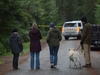 Residents look on as an RCMP vehicle blocks a road near the the scene of a small plane crash on Gabriola Island, B.C., Wednesday, Dec.11, 2019. The BC Coroners Service and police have confirmed multiple fatalities in a plane crash off the east coast of Vancouver Island.THE CANADIAN PRESS/Jonathan Hayward