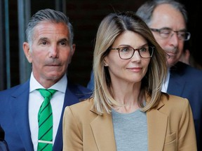 Actor Lori Loughlin, and her husband, fashion designer Mossimo Giannulli, leave the federal courthouse after facing charges in a nationwide college admissions cheating scheme, in Boston, Massachusetts, U.S., April 3, 2019.