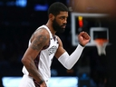 Kyrie Irving of the Brooklyn Nets pumps his fist against the against the Atlanta Hawks at Barclays Center on Jan. 12, 2020 in New York City.