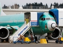 An employee works near a Boeing 737 Max aircraft at Boeing's 737 Max production facility in Renton, Washington, U.S. Dec. 16, 2019. (REUTERS/Lindsey Wasson/File Photo)