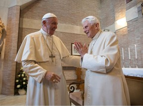 This handout picture released by the Vatican press office on November 19, 2016 shows Pope Francis (L) and Pope emeritus Benedict XVI during a meeting with newly nominated cardinals after a consistory on November 19, 2016 at the Vatican.
