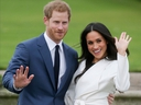 In this file photo taken on November 27, 2017 Britain's Prince Harry and his fiancée US actress Meghan Markle pose for a photograph in the Sunken Garden at Kensington Palace in west London, following the announcement of their engagement.