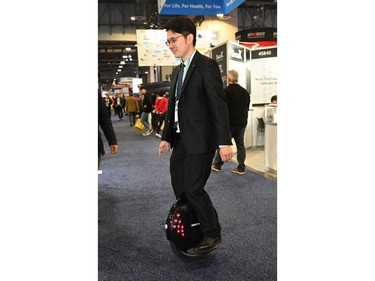 Jason Jiao of Shenzhen, China-based Inmotion Technologies rides Inmotion's newest monowheel, the Inmotion V8F at the 2020 Consumer Electronics Show (CES) in Las Vegas on Jan. 9, 2020.