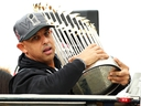 Boston Red Sox Manager Alex Cora holds the World Series trophy during the team's victory parade on October 31, 2018 in Boston. (Adam Glanzman/Getty Images)