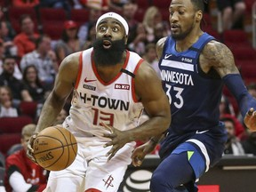 Houston Rockets guard James Harden dribbles the ball as Minnesota Timberwolves forward Robert Covington defends during the first quarter at Toyota Center.
