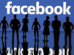 Small toy figures are seen in front of Facebook logo in this illustration picture, April 8, 2019.
