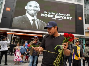 A fans mourns the death of retired NBA star Kobe Bryant outside the Staples Center prior to the 62nd Annual Grammy Awards on Jan. 26, 2020 in Los Angeles.