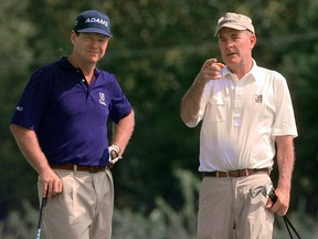 Tom Watson, left, gets some pointers from course designer Pete Dye as they wait to tee off on the par-3, 15th hole at the Brickyard Crossing golf course in Indianapolis Wednesday, Sept. 8, 1999.  (AP Photo/Michael Conroy)