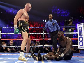Tyson Fury, left, knocks down Deontay Wilder in the fifth round during their Heavyweight bout for Wilder's WBC and Fury's lineal heavyweight title on Feb. 22, 2020 at MGM Grand Garden Arena in Las Vegas, Nevada. (Al Bello/Getty Images)
