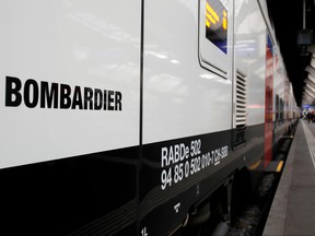 """The Bombardier FV-Dosto double-deck train """"Ville de Geneve"""" of Swiss railway operator SBB is seen at the central station in Zurich, Switzerland April 29, 2019. REUTERS/Arnd Wiegmann/File Photo"""