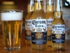 CHICAGO, IL - JUNE 07:  In this photo illustration, bottles of Corona beer are shown on June 7, 2013 in Chicago, Illinois.  Constellation Brands, one of the world's largest wine companies, is expected to become the third-largest beer supplier in the United State today with a $5.3 billion purchase of the U.S. distribution rights of Grupo Modelo beers from Anheuser Busch InBev. Corona Extra, brewed by Grupo Modelo, is the number one selling imported beer sold in the United States and the number six selling beer overall.  (Photo Illustration by Scott Olson/Getty Images) ORG XMIT: 170279470