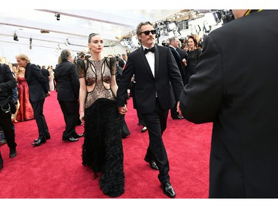 Joaquin Phoenix and Mara Rooney arrive at the red carpet at the 92nd Annual Academy Awards on Feb. 9, 2020 in Hollywood, Calif.