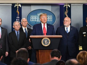 US President Donald Trump (C) speaks at a news conference with members of the Centers for Disease Control and Prevention(CDC) on the COVID-19 outbreak at the White House in Washington, DC on February 29, 2020.