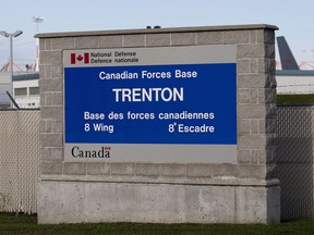 A sign for 8 Wing CFB Trenton is seen on Saturday, September 29, 2012.