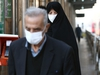 Iranian people wear protective masks to prevent contracting a coronavirus, in Tehran, Iran February 29, 2020.WANA (West Asia News Agency)/Nazanin Tabatabaee via REUTERS ATTENTION EDITORS - THIS PICTURE WAS PROVIDED BY A THIRD PARTY ORG XMIT: GGGBAG503