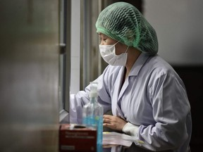A lab technician registers samples from potential victims of the novel coronavirus at the Centre for Emerging Infectious Diseases of Thailand at Chulalongkorn University in Bangkok on Wednesday, Feb. 5, 2020.