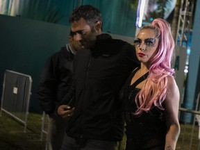 Lady Gaga, centre, leaves after Super Bowl LIV between with Michael Polansky, left, and her security guards at Hard Rock Stadium in Miami Gardens, Fla., on Feb. 2, 2020. (EVA MARIE UZCATEGUI/AFP via Getty Images)