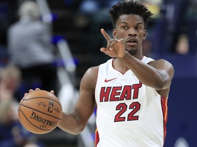 Jimmy Butler of the Miami Heat dribbles the ball against the Indiana Pacers at Bankers Life Fieldhouse on Jan. 8, 2020 in Indianapolis, Ind.   (Andy Lyons/Getty Images)