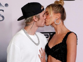 """Justin Bieber and his wife Hailey Baldwin kiss at the premiere for the documentary TV series """"Justin Bieber: Seasons"""" in Los Angeles, on Jan. 27, 2020."""